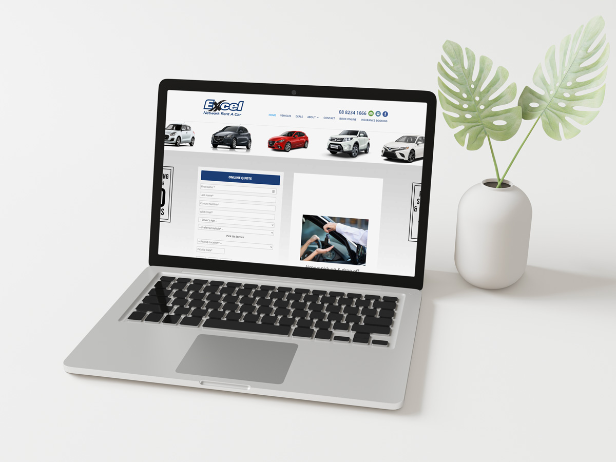 Laptop on a desk displaying the Excel Rent a Car website.